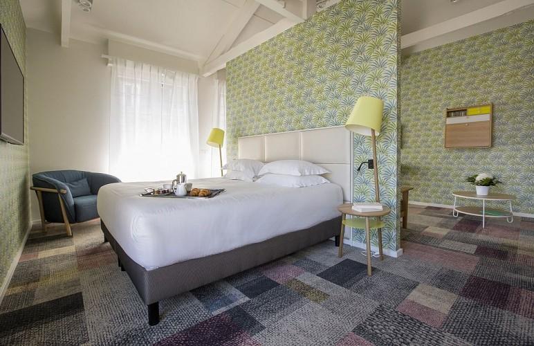 chambre-deluxe hotel silhouette balcon