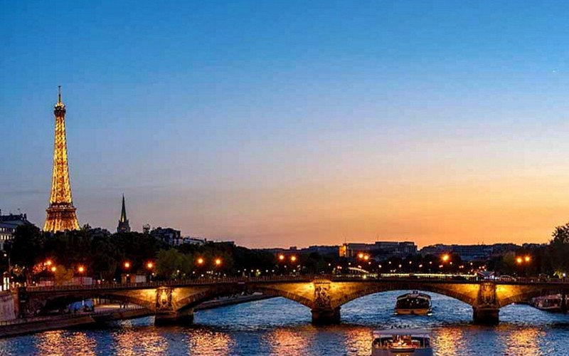 Skip the Line Eiffel Tower After Dark with Champagne River Cruise