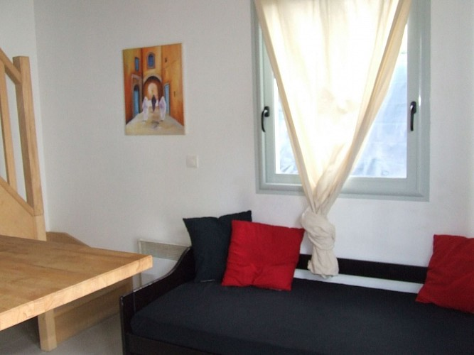 vue canapé + fenêtre côté