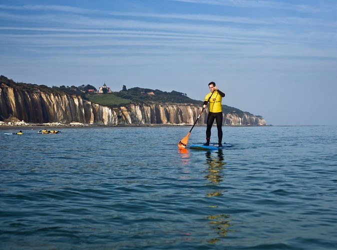 Stand-up paddle boarding along the cliffs of the Alabaster Coast