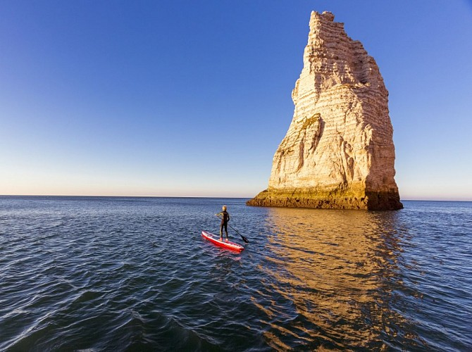 Explore the arches and needle of Etretat on a SUP board