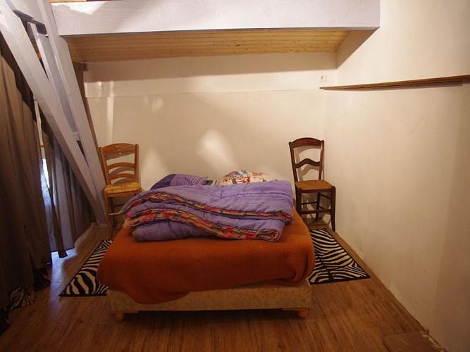 chambre séparée par rideaux
