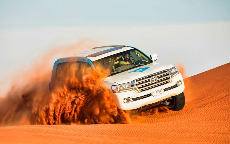 Premium Red Dunes Desert Safari & Camel Safari with BBQ Dinner at Al Khayma Camp
